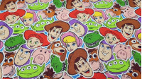 Cotton Disney Toy Story Mosaic fabric - Disney licensed cotton fabric with drawings of the characters from the movie Toy Story forming a mosaic. The fabric is 110cm wide and its composition is 100% cotton.