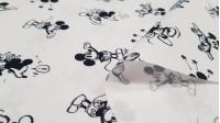 Tela Algodón Disney Mickey Diminuto Clásico - Tela de algodón licencia Disney con dibujos del personaje Mickey Mouse en su versión clásica de tamaño pequeño sobre un fondo blanco. La tela mide 150cm de ancho y su composición 100% algodón.