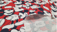 Cotton Disney Mickey Red Background fabric - Disney licensed cotton fabric with drawings of the character Mickey on a red background. The fabric is 150cm wide and its composition is 100% cotton.