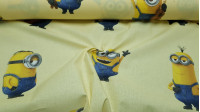 Cotton Minions Yellow fabric - Special decorative license cotton fabric with large drawings of Minions characters in various poses on a light yellow background. The fabric is 140cm wide and its composition is 100% cotton.