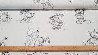 Cotton Disney Mickey Minnie Strokes fabric - Disney licensed cotton fabric with large line drawings of the characters Mickey and Minnie on a white background. The fabric is 150cm wide and its composition is 100% cotton.