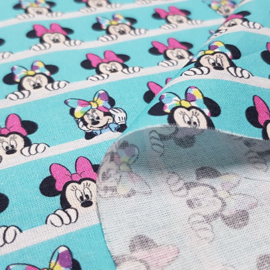 Cotton Disney Minnie Looks Out fabric - Disney licensed cotton fabric with drawings of the character Minnie looming over white lines, on a contrasting turquoise blue background. The fabric is 150cm wide and its composition is 100% cotton.