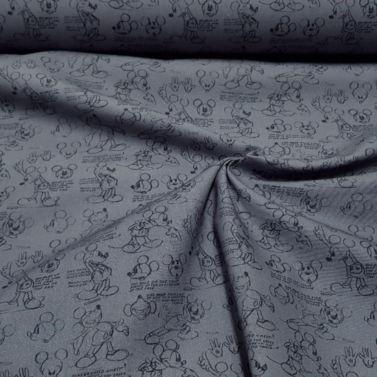 Cotton Disney Mickey Sketch fabric - Disney licensed cotton fabric with drawings of the character Mickey in strokes and sketches on a gray background. The fabric is 150cm wide and its composition is 100% cotton.