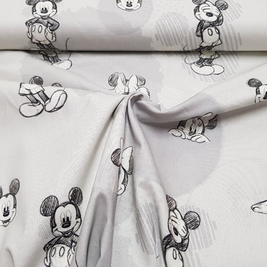 Cotton Disney Mickey Minnie Sketches fabric - Disney licensed cotton fabric with drawings of sketches of the characters Mickey and Minnie on a gray background with circular shapes. The fabric is 140cm wide and its composition is 100% cotton.