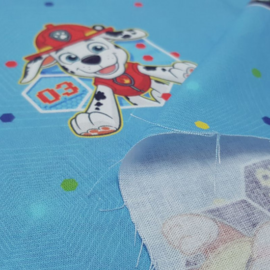 Cotton Paw Patrol Hexagons fabric - Licensed cotton fabric with drawings of the characters Chase, Marshall, Rubble, Rocky... from the children's series Paw Patrol on a blue background with colorful hexagonal shapes. The fabric is 140cm wide and its com