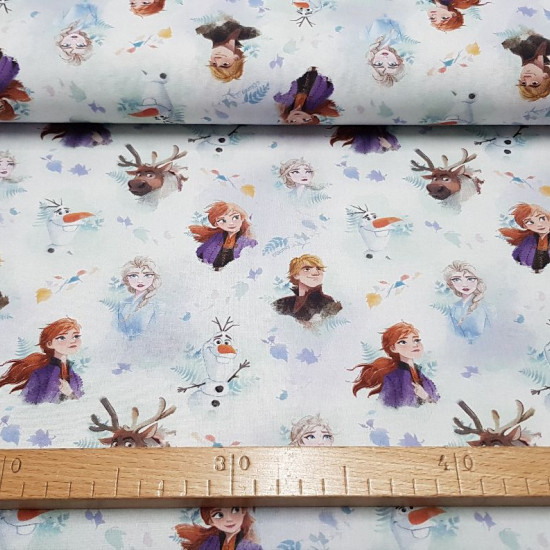 Cotton Disney Frozen 2 Characters fabric - Disney licensed cotton fabric with the characters Anna, Elsa, Sven, Kristoff and Olaf from the movie Frozen 2 forming a mosaic on a background with leaves in the air. The fabric is 150cm wide and its composition