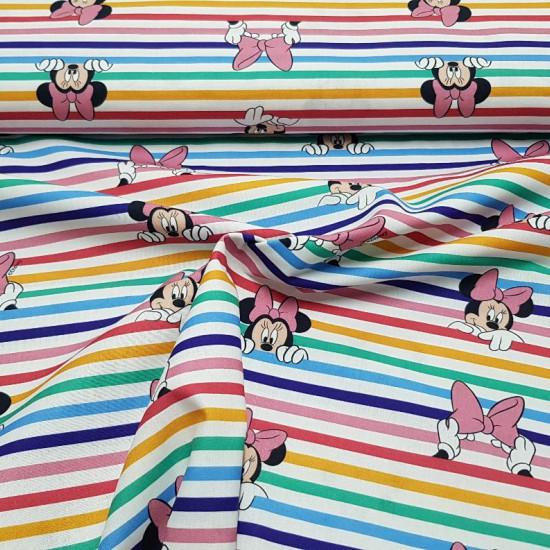 Tela Algodón Disney Minnie Asomada Arcoiris - Tela de algodón licencia Disney con dibujos del personaje Minnie asomada sobre arcoiris de rayas anchas donde también aparecen lazos rosas. La tela mide 150cm de ancho y su composición 100% algodón.