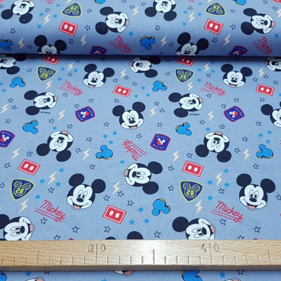Cotton Disney Mickey Stars Rays Blue fabric - Disney licensed cotton fabric with drawings of Mickey Mouse faces on a gray-blue background with drawings of rays, stars, patches, Mickey silhouettes... The fabric is 140cm wide and its composition is 100% cot