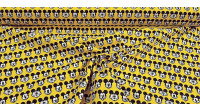 Cotton Disney Mickey Faces Yellow fabric - Disney licensed cotton fabric with drawings of Mickey faces making faces on a yellow background. The fabric is 110cm wide and its composition is 100% cotton.