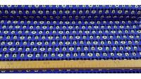 Tela Algodón Disney Mickey Caras Azul - Tela de algodón licencia Disney ancho americano con dibujos de caras de Mickey haciendo muecas sobre un fondo de color azul. La tela mide 110cm de ancho y su composición 100% algodón.