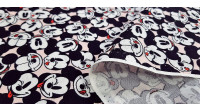 Cotton Disney Mickey Faces Allover Pink fabric - Disney licensed cotton fabric with drawings of Mickey's faces together and in various positions on a light pink background. The fabric is 110cm wide and its composition is 100% cotton.