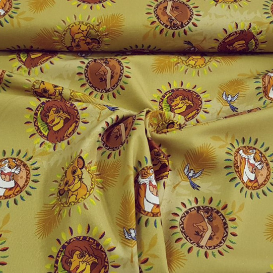 Cotton Disney The Lion King Jungle fabric - Disney cotton fabric with drawings of Simba and Timon from the Lion King and Shere Khan from the Jungle Book, on a background in yellowish-gold tones. The fabric is 140cm wide and its composition is 100% cotton.