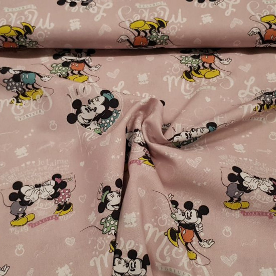 Cotton Disney Love Mickey Minnie fabric - Disney licensed cotton fabric with drawings of the characters Mickey and Minnie in love with background letters with the word love in various languages and shapes of hearts. The fabric is 150cm wide and its comp