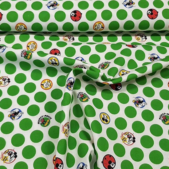 Cotton MIckey Green Polka Dots fabric - Licensed cotton fabric with Mickey Mouse drawings inside circles or dots with a white background and green dots around. The fabric is 150cm wide and its composition is 100% cotton.