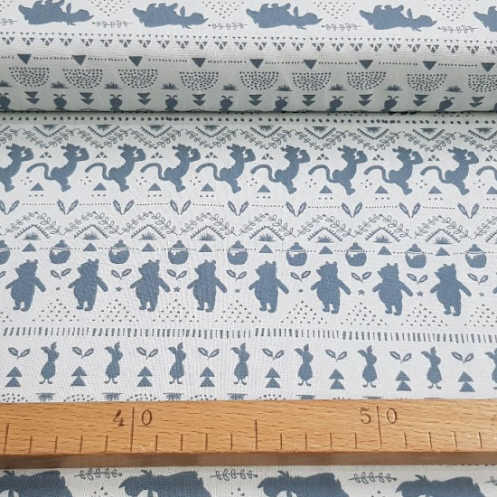 Cotton Disney Winnie Shadows fabric - Licensed cotton fabric with drawings of gray shadows with the characters of Winnie the Pooh (Tiger, Piglet, Igor and Winnie) forming a weave of geometric lines. The fabric is 110cm wide and its composition 100% cotto