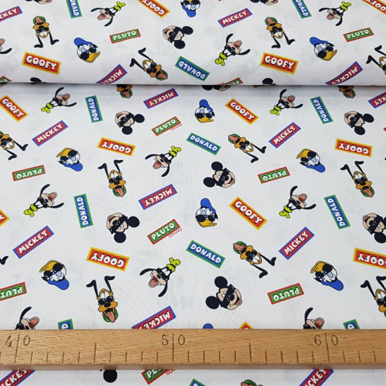 Cotton Disney Characters Signs fabric - Disney licensed cotton fabric with drawings of the classic characters Donald, Pluto, Mickey and Goofy with black glasses and colored signs with each one's name. The fabric is 150cm wide and its composition is 100