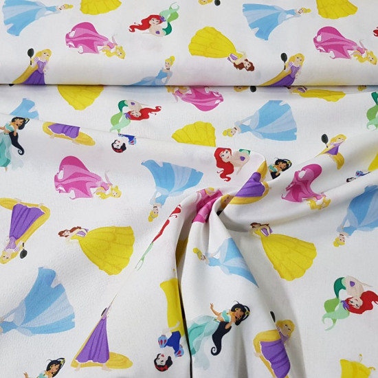 Cotton Disney Princesses Tales fabric - Disney licensed cotton fabric withprincess drawings on a white background. Princess Jasmine, Ariel, Rapuntzel, Cinderella, Bella, Aurora and Snow White appear. The fabric is 150cm wide and its composition is 10