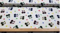 Tela Algodón Disney Mickey Caras Letras - Tela de algodón licencia Disney con dibujos de caras con el contorno de colores delpersonaje Mickey sobre un fondo blanco con letras de colores. La tela mide 150cm de ancho y su composición 100% a