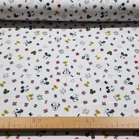 Cotton Disney Mickey Minnie Trophies fabric - Disney licensed cotton fabric with drawings of the faces of the Mickey and Minnie characters on a white background with colored letters, trophies, gloves... The fabric measures between 140-150cm wide and its c