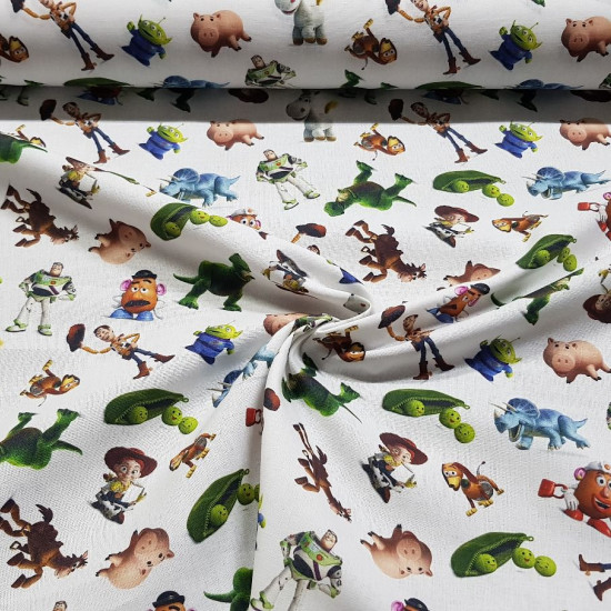Tela Algodón Disney Toy Story Personajes C - Tela de algodón licencia Disney con dibujos de los personajes de la películaToy Story sobre un fondo blanco. La tela mide entre 140-150cm de ancho y su composición 100% algodón.