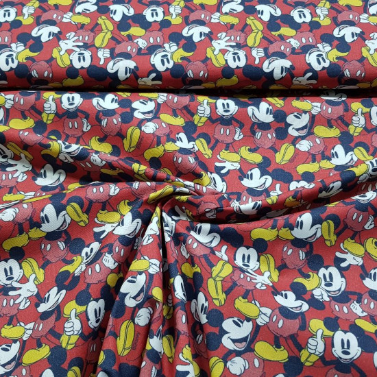 Cotton Disney Mickey Red Background C fabric - Licensed cotton fabric with drawings of the character Mickey colored on a red background. The fabric is between 140-150cm wide and 100% cotton.