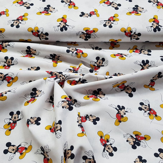 Cotton Disney Mickey Mouse fabric - Disney licensed cotton fabric with drawings of the Mickey character on a white background. The fabric measures between 140-150cm wide and its composition is 100% cotton.
