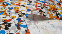 Cotton Disney Characters Collage White fabric - Licensed cotton poplin fabric with drawings of classic Disney characters such as Mickey Mouse, Donald, Pluto... forming a collage on a white background. The fabric is 140cm wide and its composition is 100% c