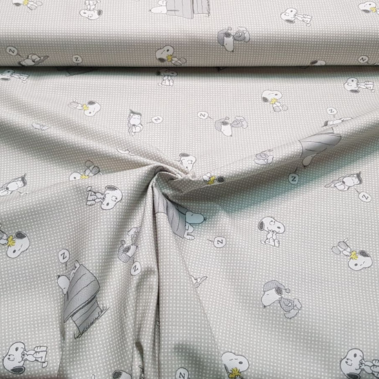 Cotton Snoopy Sleeping fabric - Licensed cotton poplin fabric with drawings of the classic character Snoopy, where he appears with Woodstock the little bird and also sleeping at home. A gray grid-like background predominates. The fabric is 140cm wi