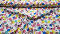 Cotton Disney Minnie Polka Dots Colors fabric - Children's cotton poplin fabric with Disney licensed drawings where the Minnie character appears in colored circles with ornaments and smiling faces. The fabric is 140cm wide and its composition is 100% cott