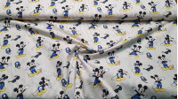 Cotton Disney Mickey Summer fabric - Disney children's cotton fabric with drawings of the character Mickey, sunglasses and music helmets, on a background of beige stripes. The fabric is 140cm wide and its composition 100% cotton.