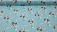 Tela Algodón Disney Mickey Triángulos - Tela de algodón Disney con dibujos de caritas de Mickey Mouse con los ojos cerrados, y dibujos de triángulos sobre un fondo azul verdoso. El tejido mide 110cm de ancho y la composición es 100% algodón.