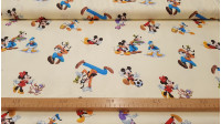 Cotton Disney Mickey and Friends fabric - Children's cotton fabric with Disney characters Mickey, Minnie, Goofy and Donald on a light yellow background.