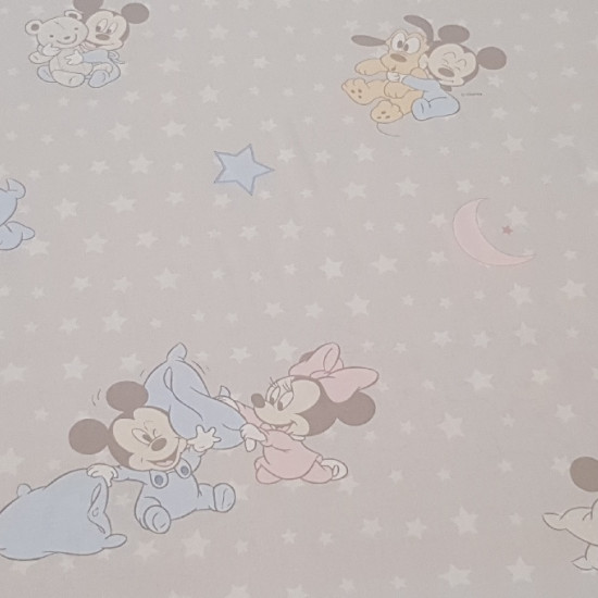 Cotton Disney Mickey Minnie Babies fabric - Disney children's cotton fabric with drawings of the characters Mickey and Minnie of babies on a gray background with white stars and moons.
