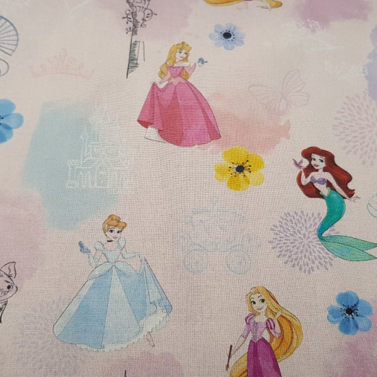 Cotton Disney Princesses Blue fabric - Disney cotton fabric with the drawings of princesses like Ariel, Rapuntzel, Bella, Snow White, Cinderella and Aurora on a light blue background with hearts.