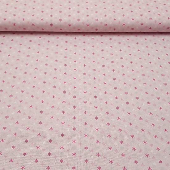 Tela Algodón Estrellas Tonos Rosas - Tela de algodón con dibujos de estrellas en tonos rosa, fucsia, gris y blanco sobre un fondo rosa claro. La tela mide 150cm de ancho y su composición 100% algodón