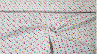 Cotton Stars Colors fabric - Cotton fabric with drawings of colored stars and various sizes on a white background. The fabric is 150cm wide and its composition is 100% cotton.