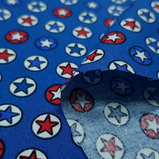 Cotton Stars Circles fabric - Poplin cotton fabric with drawings of stars within circles that remind us of superhero stars. The fabric is 140cm wide and its composition is 100% cotton.