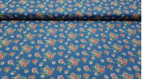 Cotton Roses Texan fabric - Fine cotton fabric with drawings of red and pink roses on a blue denim background. The fabric is 145cm wide and its composition 100% cotton