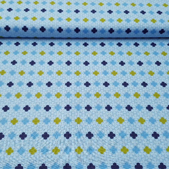 Cotton Four Blue Petals fabric - Cotton fabric with four petal flower patterns intertwined in shades of blue and green colors. The fabric is 150cm wide and its composition 100% cotton.