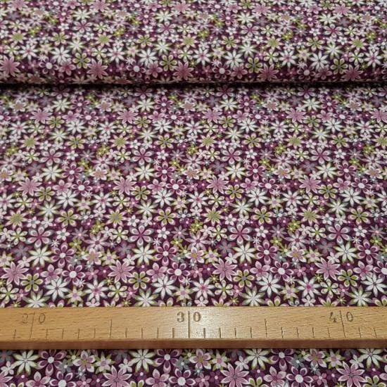 Tela Algodón Flores Variadas - Tela de algodón con dibujos de flores de varios tamaños y colores, predominando los tonos morados y lilas. Tela muy recomendadapara las creacionesde patchwork. La tela mide 150cm de ancho y su composición 100% algo
