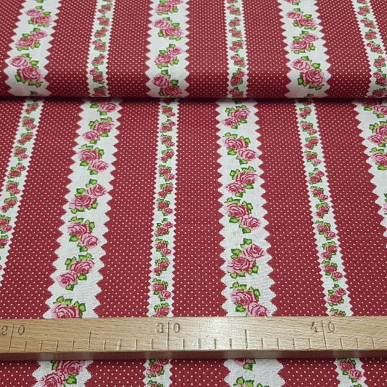 Cotton Roses and Polka Dots Red fabric - Cotton fabric with drawings of white borders with roses and small white spots on a red background. The fabric is 140cm wide and its composition is 100% cotton.