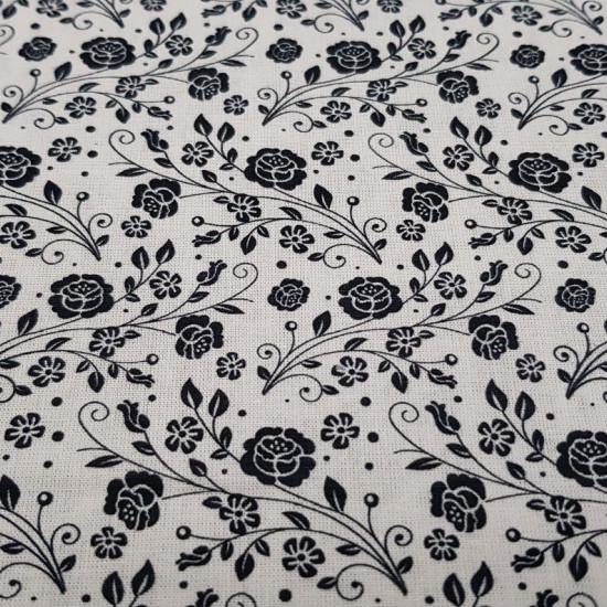 Tela Algodón Flores - Tejido de algodón ideal para Patchwork con dibujos de flores negras sobre fondo blanco. La tela mide 150cm de ancho y su composición 100% algodón.
