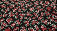 Tela Algodón Flores Rojas Fondo Negro - Tejido de algodón tipo popelín con dibujos de flores pequeñas rojas sobre un fondo negro. La tela mide 150cm de ancho y su composición 100% algodón.