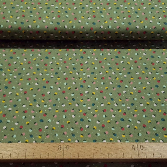 Cotton Flowers Dots Green fabric - Organic cotton fabric with floral patterns with white polka dots on a green background. The fabric is 150cm wide and its composition is 100% cotton.