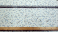Cotton Voile Blue Flowers fabric - Fine and light batiste / voile cotton fabric with blue flower patterns on a white background. The fabric is 150cm wide and its composition is 100% cotton.