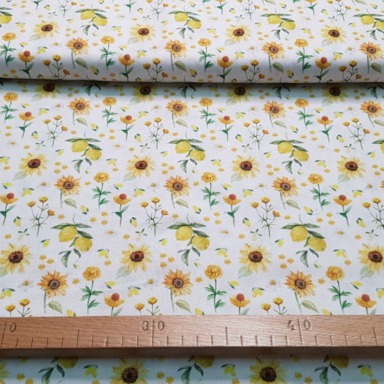 Cotton Sunflowers Lemons fabric - Organic cotton fabric (GOTS) with drawings of sunflowers and lemons on a white background. The fabric is 150cm wide and its composition is 100% cotton.