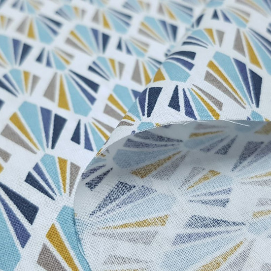 Cotton Mosaic Ornamental Fans fabric - Poplin cotton fabric with geometric drawings mosaic of shapes like fans formed by triangles where blue colors predominate on a white background. The fabric is 150cm wide and its composition is 100% cotton.