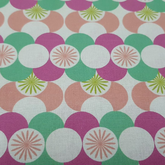 Cotton Mosaic Circles Colors 4004 fabric - Cotton poplin fabric with circular patterns forming very colorful mosaics. The fabric is 150cm wide and its composition is 100% cotton.
