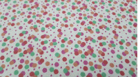 Cotton Multicolor Polka Dots White Background fabric - Cotton Poplin fabric with drawings of disparate sizes of polka dotscolors on a white background. The fabric is 150cm wide and its composition is 100% cotton.