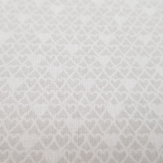 Cotton White and Gray Hearts fabric - Cotton fabric with drawings of small white and gray hearts forming a pattern. The fabric is 150cm wide and its composition is 100% cotton.